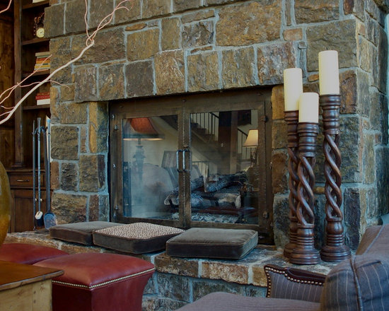 Fireplaces - Custom designed, hand forged, wrought iron fireplace screen and insert with stone hearth.
