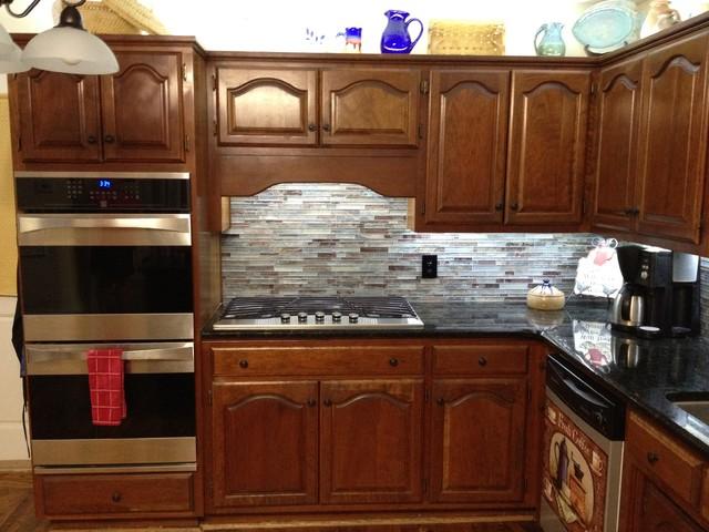 Floreste Verde Granite & Glass Mosaic Backsplash traditional-kitchen-countertops