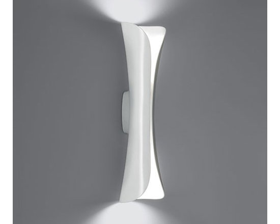 Artemide - Artemide | Cadmo LED Wall Light - Design by Karim Rashid.The Cadmo LED Wall Light provides direct and indirect lighting. Composed of an injection-molded thermoplastic body with a reflector in optic aluminum. Non dimmable. The Cadmo LED Wall Light is available in black, white or red finishes.UL Listed.