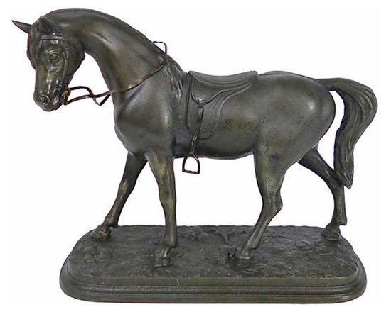 Cast Iron Horse - Beautifully detailed cast iron horse statue. The horse is standing in a field of flowers and wearing a western saddle with articulating metal reins and stirrups.