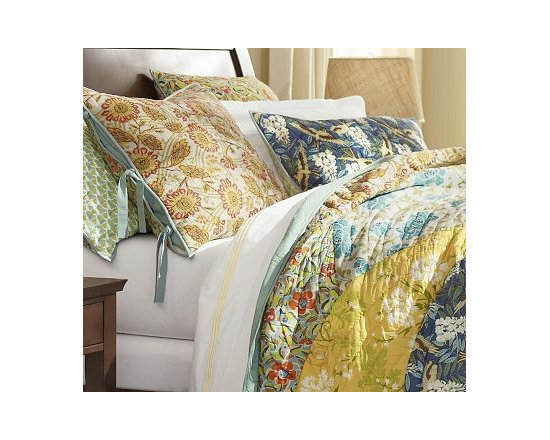 Scalloped Organic Cotton Patchwork Quilt, Full/Queen - Our Scalloped Organic Patchwork Quilt captures the spirit of art nouveau, with its flowing, curvilinear forms and stylized botanicals.All-cotton quilt is hand made.Organic cotton cambric quilted over all-cotton batting.Overlapping fan-shaped patches are edged with porcelain-blue piping.Quilt reverses to solid blue.Shams feature a different print on each side and side ties for easy reversibility.Inserts sold separately.Machine washable.Watch a video on {{link path='/stylehouse/videos/videos/pbq_v10_rel.html?cm_sp=Video_PIP-_-PBQUALITY-_-QUILTS_AMERICAN_ART' class='popup' width='950' height='300'}}quilting as an American art form{{/link}}.Catalog / Internet Only.Imported.