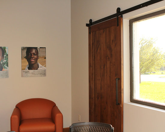 Lifesong for Orphans - Lifesong for Orphans used Nylon Barn Door Hardware for window shutters. Very innovative and looks great.