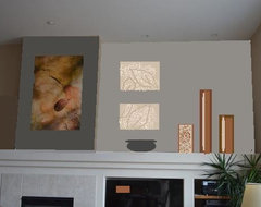 Arrangement with Darker FP Wall and Sepia Photos contemporary-interior-elevation
