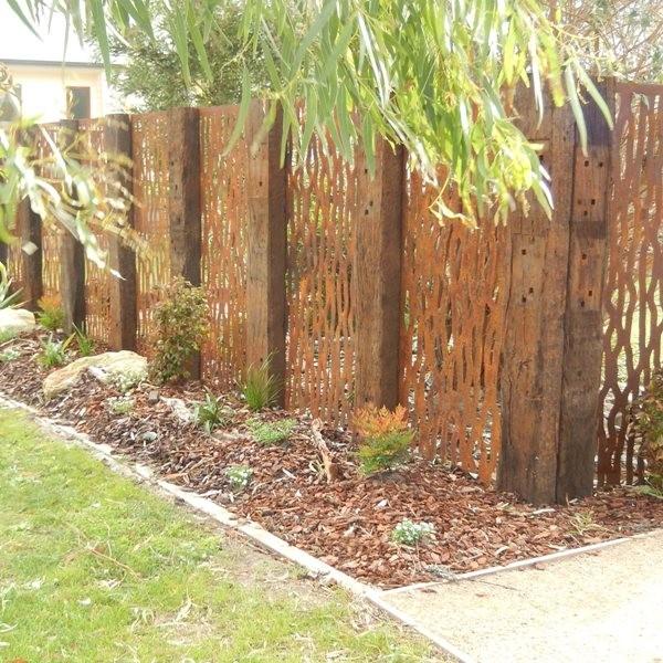 Vine metal rust screens in between old railway sleepers for Metal garden dividers