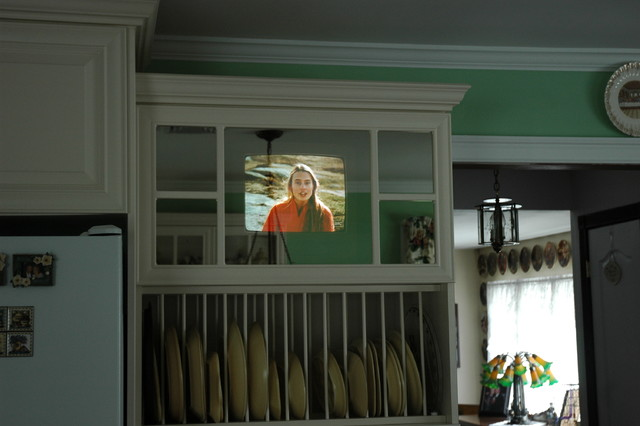 Two way mirror for TV traditional-kitchen-cabinetry