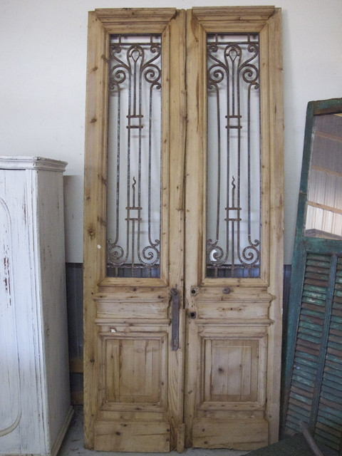 Pair of antique pine doors with iron inserts eclectic windows and doors