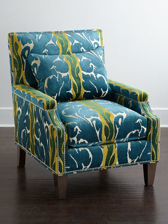 """Massoud - Amagosa Chair - BLUE/YELLOW - MassoudAmagosa ChairDetailsEXCLUSIVELY OURS.Handcrafted chair.Hardwood frame.Rayon/polyester upholstery.29""""W x 36""""D x 29""""T. Seat 21""""W x 25""""D x 19""""T; arms 24""""T.Made in the USA.Boxed weight approximately 100 lbs. Please note that this item may require additional shipping charges.Designer About Massoud:Company president Chuck Massoud's father combined his entrepreneurial spirit with loans from three friends to start Massoud Furniture in 1962. Since then the Massoud family has been crafting its distinctive brand of custom seating. Massoud is credited for putting pitch in their wing chairs leaning them back slightly makes them so much more comfortable than the classic wing chair with a straight back. All Massoud furniture features kiln-dried hardwood frames and the finest leathers and fabrics available. They also employ multiple support rails reinforced corner blocks mortise-and-tenon joinery and suspended coil systems for comfort and quality craftsmanship that lasts a lifetime."""
