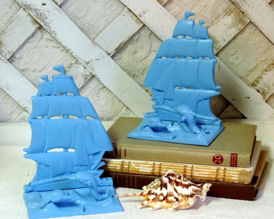Seaside Living:Turquoise Painted Vintage Brass Sailboat and Dolphin Bookends - These turquoise painted vintage brass sailboat and dolphin bookends would be a lovely accent to a table top or bookshelf in a seaside cottage.