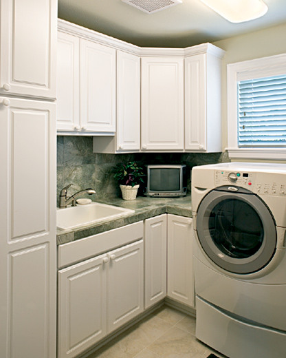 ... Bay doors styles in white Thermofoil mediterranean-laundry-room