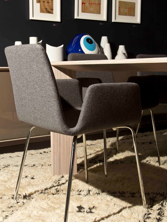 Duane Dining Chair by Nuans Design - Plywood molded seat shell fully padded and upholstered in high quality foam. Chrome plated metal legs.