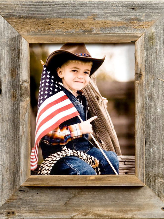 MyBarnwoodFrames - 8x16 Cowboy Picture Frame, Medium Width 3 inch Western Rustic Series  Si - Cowboy  Picture  Frame  from  the  Heart  of  America    Your  Cowboy  Picture  Frame  won't  get  any  more  authentic  than    this.   Built  from  reclaimed  barnwood  harvested  in  the  heart of  the    American  West,  these  handmade  rustic  frames  will  complement  any  country    rustic  decor.          Frame  is  crafted  from  authentic  barnwood    One 8x16    photo  opening    Frame  width:   3    Flat  outer    frame  is  2-1/2  inches  wide,  interior  casing  for  the    frame  is  1/2-3/4    inches  wide    Depth  of  interior  shadowbox  is  approximately    1/2  inch.    Includes  glass,  backing  and  hanging  hardware        The  flat outer  edge  of  the  Cowboy  Picture  frame  is  2  1/2  inches  wide    with  a  1/2  inch  interior  casing,  making  the  entire  frame  width  just  over    3  inches  wide.   This  generous  frame  width  highlights  the  beautiful    textures  and  colors  of  the  natural  barnwood  without  overpowering  the    framed  subject.      This  barnwood  frame  is    appropriate  for  any  decor  that  includes    primitive  wood  (in  a  summer    cabin  or  a  cozy  ski lodge,  for  example).    Another  benefit  of  rustic  barnwood  frames  is  that  they    are  suitable  for    such  a  large  range  of  subject  matter.   Purchase    several  to  frame  your    collection  of  Nashville-themed  poster  prints,  or    create  a  collage  to    show  off  your  bird  watching  photographs.   Frame  an    embroidered  sampler    or  a Native  American  sand  painting.  The    possibilities  are  almost    limitless.     Because  of  its  shadowbox  look,  this  cowboy  picture  frame  lends  itself    to  all  kinds  of  creativity.   Remove  the  backing,  frame  a  piece  of    antique  stained  glass  and  center  it  over  a  sunny  window.   Insert  a    colorful  mat  and  frame  a  few  sprigs  of  ripened 