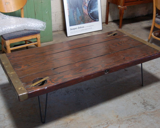 Salvaged Hatch Door Coffee Tables - Made from a vintage WWII ear Hatch door.