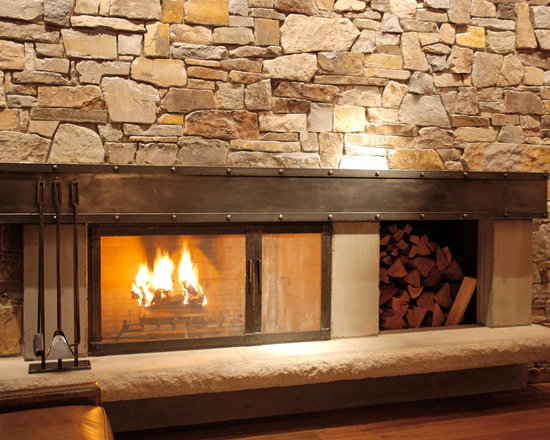 Fireplaces - Contemporary custom designed, hand forged wrought iron fireplace hearth.