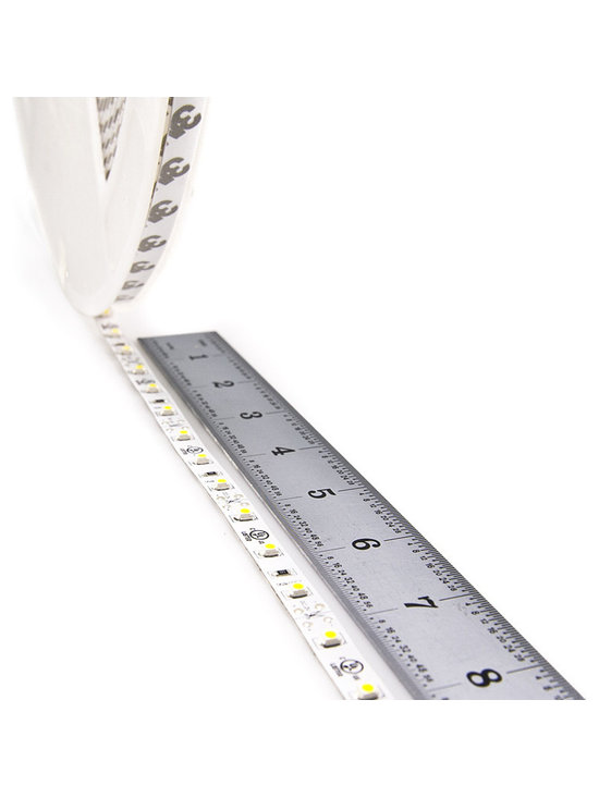 Full Reel LED Flexible Light Strip - 31m (101ft) - NFLS series Non-Waterproof flexible LED Strip is now available in full length reels. 1860 High power 3528SMD LEDs. LED flexible light strips with adhesive backing, can be cut into 3-LED (5cm / 1.97in) segments. 12VDC operation. Full reel is 31 meters (101ft) length. Strip must run back to the power source every 10m (32ft) to avoid excessive voltage drop.