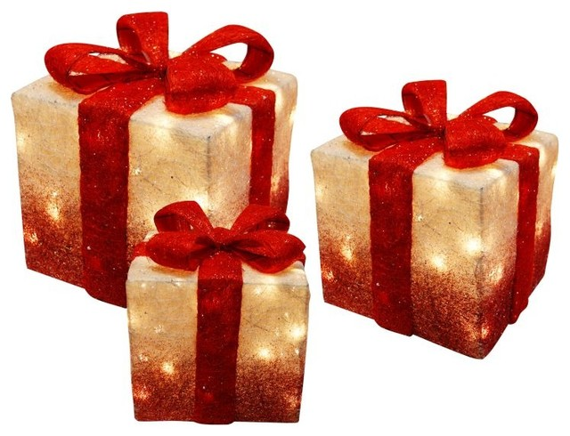 Set of white christmas presents with red bow and lights