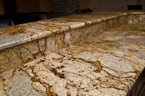 Would black appliances & oak cabinets compliment this countertop?