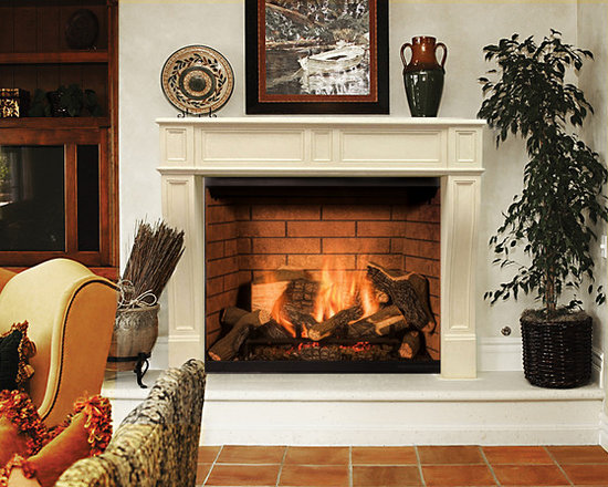 precast stone fireplace mantel and raised hearth by Studio Design Works -