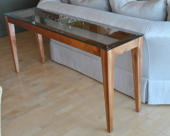 "Mahogany & Glass Console Table - A contemporary console table in solid mahogany, with a 1/2"" tempered glass top. 12"" deep x 60"" long x 30"" tall. This table was designed to fit the sofa shown. The design is fully customizable. Please contact Turner Custom Furniture for more information."