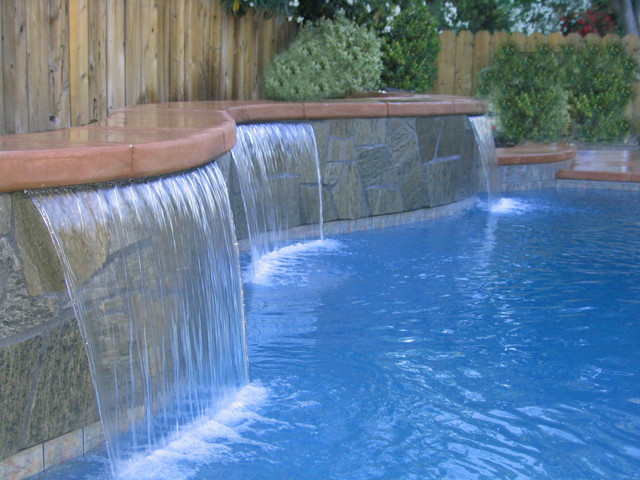 Pool scapes and standard sheeting waterfalls other metro for Waterfall design definition
