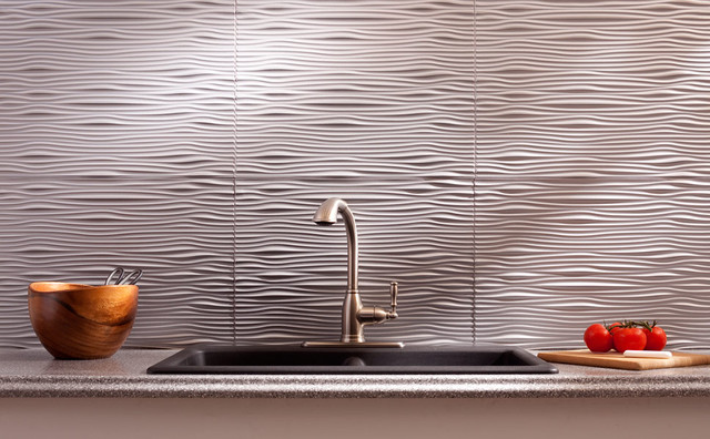 Travertine and glass tile backsplash