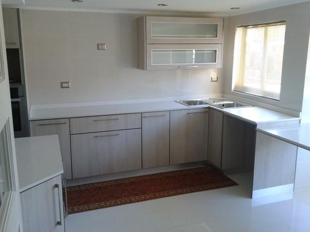 Kitchen with White Silestone contemporary