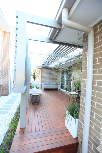 Enclosed Outdoor Room and Courtyard with Open Pergola contemporary-patio