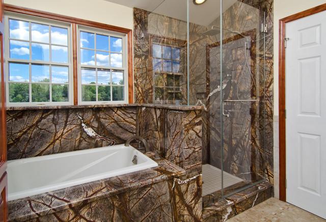 Mark Petinga photo, Granite Grannies - Rainforest Brown granite in a bathrrom tropical-showers