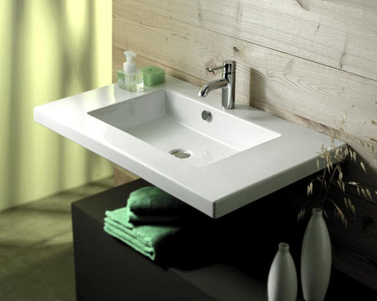 "Tecla - Wide Rectangular Ceramic Wall Mounted, Above Counter, or Drop-In Sink - This wide rectangular white ceramic sink can be installed as a wall mounted, above counter vessel, or drop-in vanity sink. A stylish addition to any bathroom, this sink comes with overflow and is available with no faucet holes, one hole (as shown), or 3 holes. Sink is made in Italy by Tecla. Sink dimensions: 35.43"" (width), 21.26"" (depth)"
