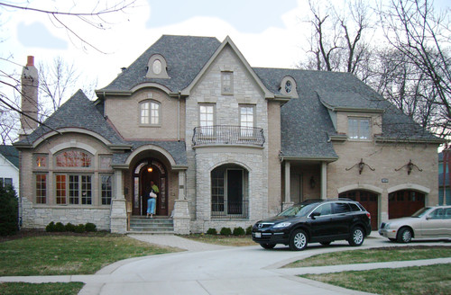 What Colors Of Brick Stone And Roof Are Used On This House