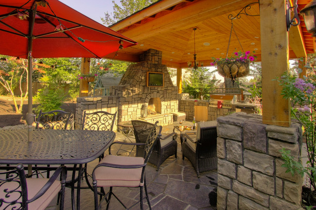 Outdoor living, gazebo, outdoor fireplace, water feature. traditional