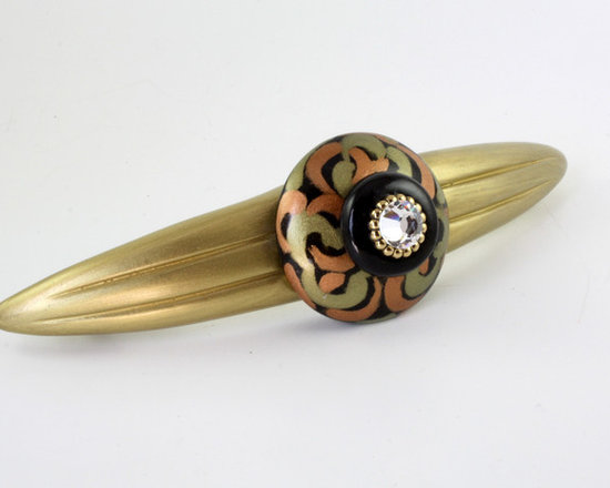 "Susan Goldstick, Inc. - Orbit Grand Tiki Cabinet Pull - Orbit Grandtiki drawer pull is 7 "" w with 5"" hole spread.  Cast  in resin and hand sculpted, pull is colored in gold, black, jade green and brown with crystal.  Coated with a durable varnish  for use in kitchens and baths."