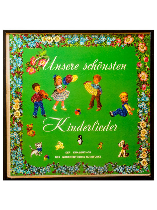 "Glittered Kinderlieder Album - Glittered record album. Album is framed in a black 12x12"" square frame with front and back cover and clips holding the record in place on the back. Album covers are original vintage covers."