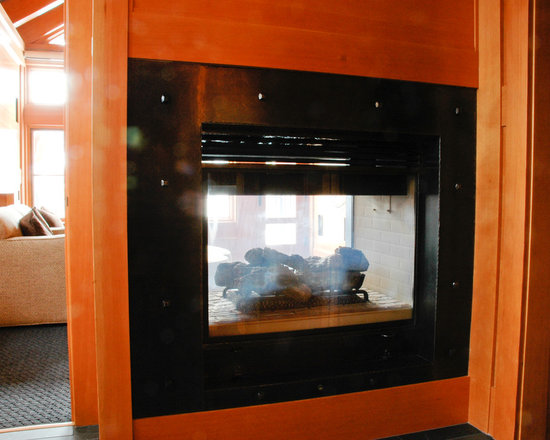 Fireplaces - Custom designed, hand forged, wrought iron modern fireplace insert and hearth.