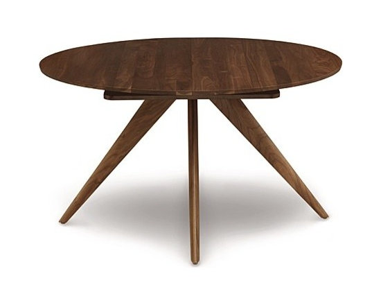 "Copeland Furniture - Catalina Round Extension Table, 54 Inches | Copeland Furniture - Hand-crafted in Vermont by Copeland Furniture.Add excellent craftsmanship to small dining spaces with the Catalina Round Extension Table, 54 Inches. Constructed from solid cherry or walnut hardwood, the tapered legs of this dining table radiate out from a central point for a dynamic look. Easily expand the table to accommodate more guests using the self-storing butterfly leaf that stores directly inside the table and creates an oval table when employed. Bring mid-century modern style to compact spaces with the Catalina Round Extension Table, 54 Inches.  Copeland Furniture uses sustainably harvested hardwoods from the American Northern Forest. All lumber used by Copeland Furniture comes from within 500 miles of their factory in Vermont, thus reducing fossil fuel consumption and carbon dioxide emissions from transportation. The environmental values of preservation and stewardship are reflected in every piece of furniture produced by Copeland Furniture.  Product Features:  Self equalizing, ball bearing extension glides Single 24"" wide self-storing butterfly leaf Single handed operation Expands up to 78"" wide  Finished with a low sheen top coat Made to order in the U.S.A."