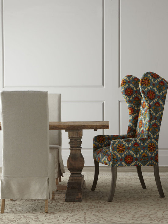 Natural Dining Table & Upholstered Dining Chairs - Casual, comfortable dining just got easier with this surprising mix of natural wood, neutral upholstery, and explosive color.