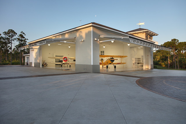 Residential airplane hanger florida vernacular style for Aircraft hanger designs