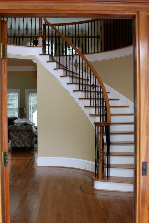 Need help for my foyer entry rounded staircase is for Round staircase designs interior