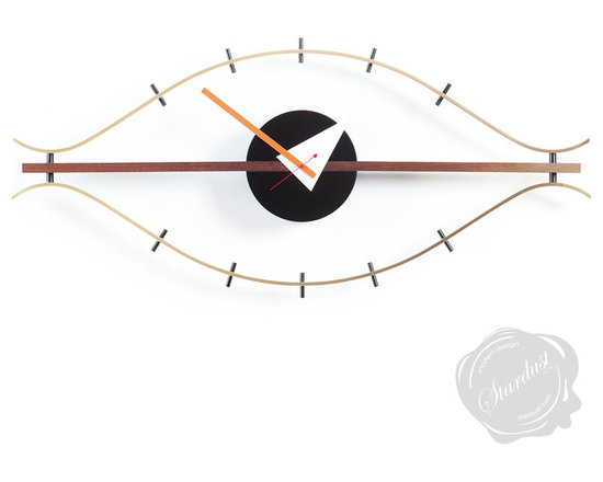 """George Nelson Eye Clock by Vitra - George Nelson Eye Clock.  The Eye Clock, designed by George Nelson in 1957, is a striking addition to any room. It is one of a number of Nelson's designs which re-invents everyday objects and give them a new, high-design profile. As one of the founders of American Modernism, George Nelson produced numerous popular consumer products that gained iconic design status. The Eye Clock has a unique form that will add an artistic flair to any interior.  Considered as one of the founders of American Modernism, George Nelson is celebrated for designing most of the 20th century's most iconic Modernist furniture. Born in Hartford, Connecticut in 1908, Nelson graduated from Hartford Public High school before studying architecture at Yale University. Driven towards creating aesthetically beautiful and innovative furniture, Nelson condemned any connotation of applying a set formula towards design. He was famously quoted as blasting, """"Design is not science and it never will be."""" Alongside winning numerous awards for his iconic furniture designs, Nelson published several books and held the role as editor for Industrial Design Magazine. The American left a legendary legacy to a future generation of designers by establishing and organising influential conferences, such as the Aspen Design gatherings.  Available from:  http://www.stardust.com/SEARCH.html?q=george+nelson+eye+clock"""