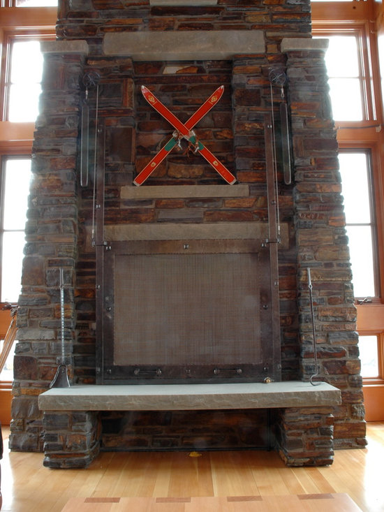 Fireplaces - Custom designed, hand forged, wrought iron and stone fireplace.