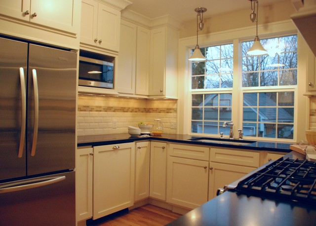 Traditional kitchen featuring cream painted shaker cabinetry traditional-kitchen