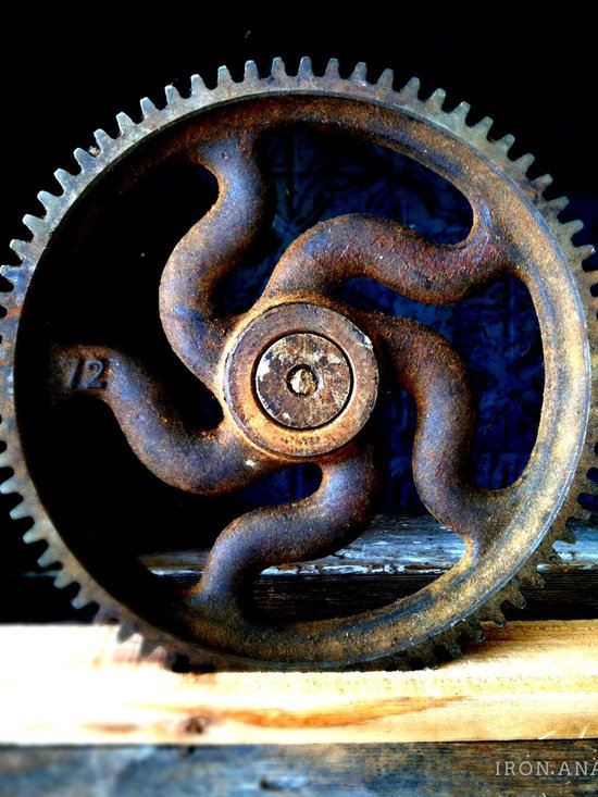 Antique Industrial Gear Decor - Very rare mid-1800s gear of cast iron with curved spokes and an embossed numeral indicating the number of teeth along its wide rim. Sits in a rustic reclaimed lumber display stand.