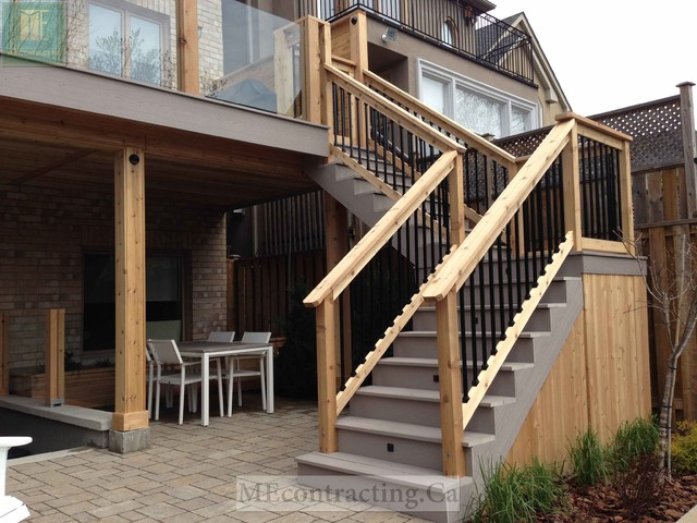 Pvc deck with glass railings and walkout basement modern Walkout basement deck designs