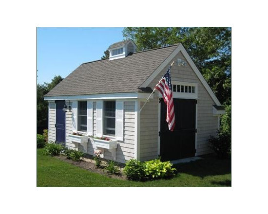 "14' x 20' Custom Building - This utilitarian building has a side 3' 2-panel beaded door, and a 6' double beaded door with a 6' transom window atop. Architectural roofing and custom trim with returns match the house. Pre-stained cedar shingles on 4 walls and a custom cupola open to the inside. Charming 30"" Estate window boxes beneath PVC double hung windows. Doors painted by owner. Concrete slab is supplied by owner."