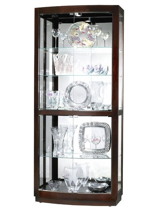 """Howard Miller - Bradington Curved Glass Door Curio Cabinet in - Bright halogen interior illumination and four curved front glass doors create a statement with this transitional collector�۪s cabinet. Warm black coffee finish, nickel tone accents and reflective mirrored glass back show off your collection with elegant style and optimal security. Adjustable floor levelers, and cushioned shelf clips create instant stability and security for your collection. * This transitional collectors cabinet features four curved front glass doors with nickel finished hardware.. Black Coffee finish on select hardwoods and veneers.. Halogen lighting for brighter, whiter, longer-lasting light to illuminate your collectibles.. Adjustable levelers under each corner provide stability on uneven and carpeted floors.. Cabinet is illuminated by an interior light.. Glass shelves can be adjusted to any level within your cabinet.. Glass mirrored back beautifully showcases your collectibles.. Plate grooves in the glass shelves allow for vertical display of your collectible plates.. No-ReachT light switch is conveniently located on the back of the cabinet.. Pad-LockT cushioned metal shelf clips increase stability and safety.. Touch-LiteT adjustable light switch offers four levels of lighting: low, medium, high, and off.. A handy key holder is attached.. H. 82"""" (208 cm). W. 36"""" (91 cm). D. 17"""" (43 cm)"""