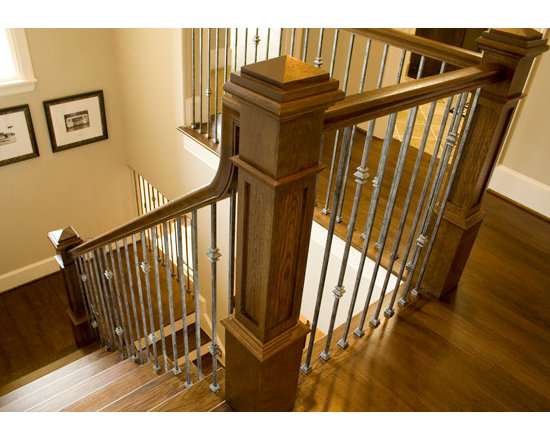 Home Stair Remodel - This stair remodel uses Antique Nickel wrought iron balusters, red oak treads, red oak handrail and red oak recessed panel box newel. CheapStairParts.com