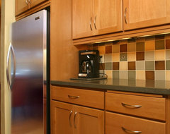 Small Kitchen Transforms to Provide Ample Storage Space traditional