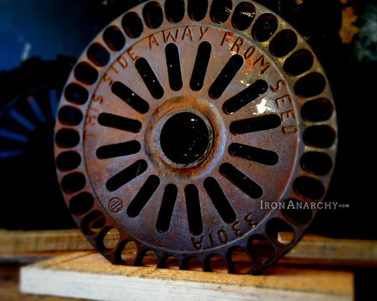 """Antique Industrial Gear Decor - Fantastic antique gear of thick cast iron in a hardcore industrial design. Engraved text to make it even more intriguing! Rustic reclaimed lumber display stand. 7 5/8"""" diameter."""