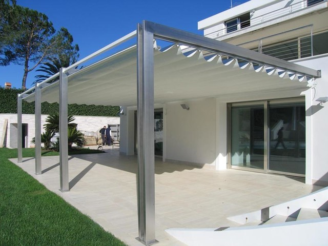 Pergotenda patio awnings with retractable roofs by for Retractable patio awning canopy