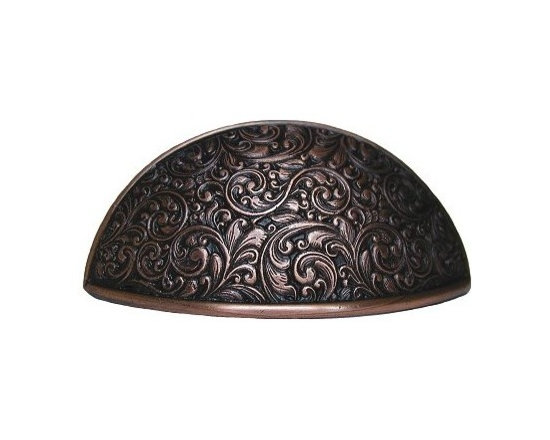 """Inviting Home - Saddleworth Bin Pull (antique copper) - Hand-cast Saddleworth Bin Pull in antique copper finish; 3-7/8""""W x 1-1/2""""H; C to C = 3""""; Product Specification: Made in the USA. Fine-art foundry hand-pours and hand finished hardware knobs and pulls using Old World methods. Lifetime guaranteed against flaws in craftsmanship. Exceptional clarity of details and depth of relief. All knobs and pulls are hand cast from solid fine pewter or solid bronze. The term antique refers to special methods of treating metal so there is contrast between relief and recessed areas. Knobs and Pulls are lacquered to protect the finish. Detailed Description: The Saddleworth pulls and the Saddleworth bin pulls both look intricate and interesting. The pulls are rectangular shaped while the bin pulls have a bit more of a dome look to them. They both can be used with the Saddleworth knobs. You may use the knobs on the doors the pulls on the smaller drawers and the bin pulls on the larger or wider drawers. That way you will get a variety of shapes and sizes while still keeping to the same design."""