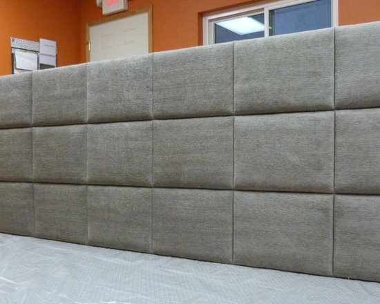 Wall of upholstered panels